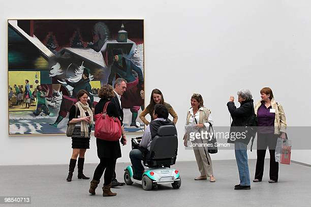German artist Neo Rauch and his wife Rosa Loy chat with visitors at Pinakothek der Moderne art museum on April 19 2010 in Munich Germany Due to his...
