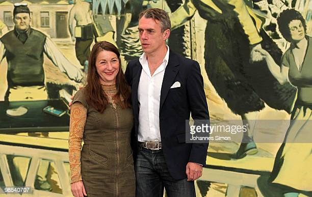 German artist Neo Rauch and his wife Rosa Loy pose in front of his painting 'Kalimuna' at Pinakothek der Moderne art museum on April 19 2010 in...