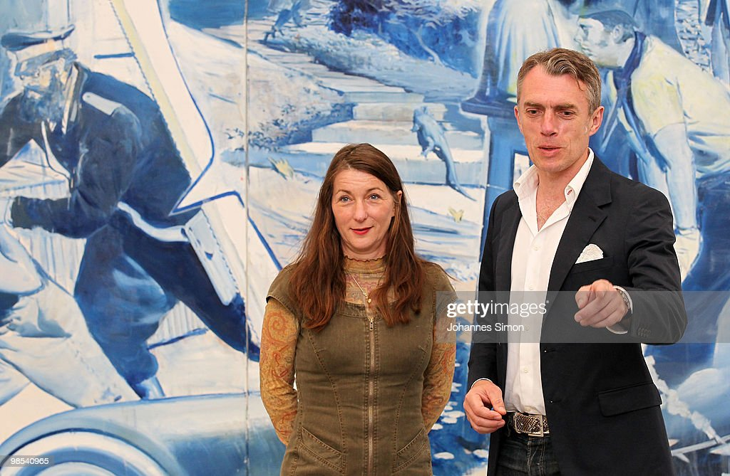 German artist <a gi-track='captionPersonalityLinkClicked' href=/galleries/search?phrase=Neo+Rauch&family=editorial&specificpeople=5589887 ng-click='$event.stopPropagation()'>Neo Rauch</a> (R) and his wife Rosa Loy pose in front of Rauch's painting 'Das Blaue' at Pinakothek der Moderne art museum on April 19, 2010 in Munich, Germany. Due to his 50th birthday Rauch is honoured by retrospective exhibitions at Leipzig and Munich. The Munich retrospective runs until 15th of August 2010.