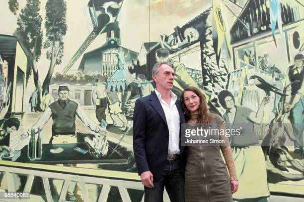 German artist Neo Rauch and his wife Rosa Loy pose in front of Rauch's painting 'Kalimuna' at Pinakothek der Moderne art museum on April 19 2010 in...