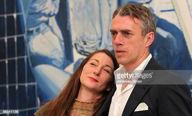 German artist Neo Rauch and his wife Rosa Loy pose in front of Rauch's painting 'Das Blaue' at Pinakothek der Moderne art museum on April 19 2010 in...