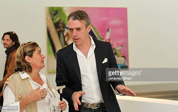 German artist Neo Rauch chats with visitors at Pinakothek der Moderne art museum on April 19 2010 in Munich Germany Due to his 50th birthday Rauch is...