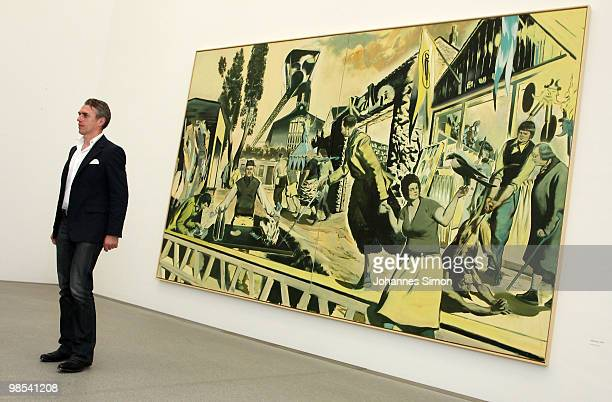 German artist Neo Rauch poses in front of his painting 'Kalimuna' at Pinakothek der Moderne art museum on April 19 2010 in Munich Germany Due to his...