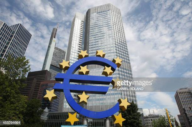 German artist Ottmar Hoerl 's sculpture depicting the Euro logo is pictured in front of the European Central Bank ECB in Frankfurt am Main western...