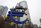 German artist Ottmar Hoerl 's sculpture depicting the Euro logo is pictured in front of the European Central Bank in Frankfurt am Main western...