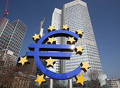 German artist Ottmar Hoerl 's sculpture depicting the Euro logo is seen in front of the European Central Bank ECB in Frankfurt am Main central...