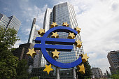 German artist Ottmar Hoerl 's sculpture depicting the Euro logo is seen in front of the former headquarters of the European Central Bank in Frankfurt...