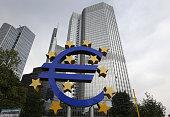 German artist Ottmar Hoerl 's sculpture depicting the Euro logo is seen outside the European Central Bank in Frankfurt/Main western Germany on...