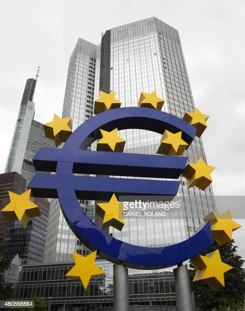 German artist Ottmar Hörl 's sculpture depicting the Euro logo is pictured in front of the former headquarters of the European Central Bank in...