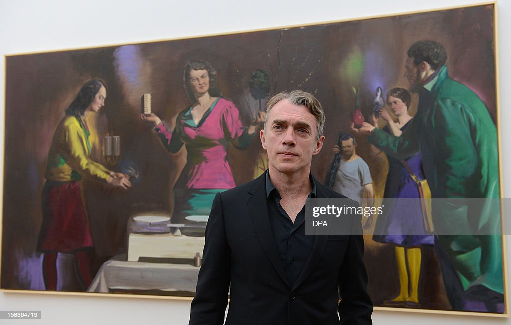 German artists Neo Rauch poses in front of his work 'Die Abwaegung' (The Consideration) during a preview of a double exhibition with works by Rauch and his wife at the Kunstsammlungen Chemnitz museum in Chemnitz, eastern Germany, on December 14, 2012. From December 16, 2012 to February 10, 2013, the museum will present simultaneously the show 'Gravitation' with works by Rauch's wife Rosa Loy and the show 'Abwaegung' (consideration) with works by Neo Rauch.