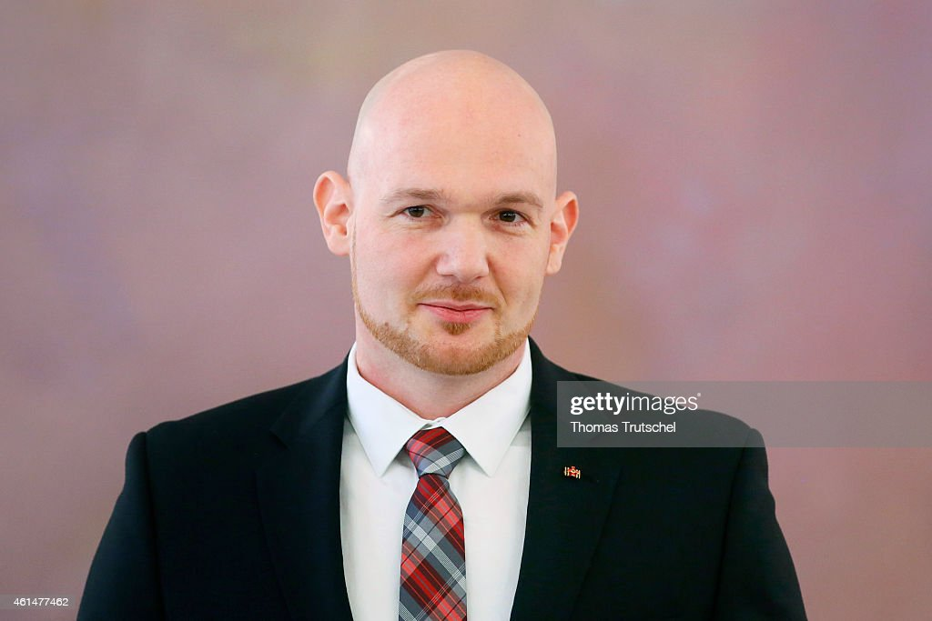 German astronaut <a gi-track='captionPersonalityLinkClicked' href=/galleries/search?phrase=Alexander+Gerst&family=editorial&specificpeople=5862799 ng-click='$event.stopPropagation()'>Alexander Gerst</a> poses for a photograph after he distinguished with Officer's Cross of the Order of Merit of the Federal Republic of Germany during a ceremony at the presidential palace on January 13, 2015 in Berlin, Germany.