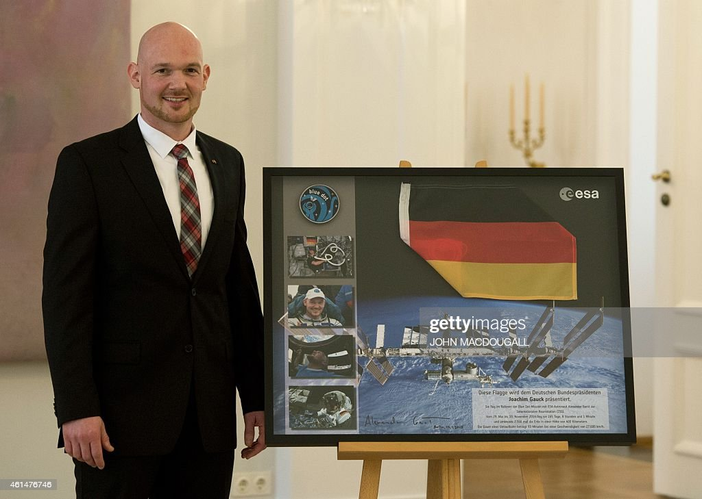 German astronaut <a gi-track='captionPersonalityLinkClicked' href=/galleries/search?phrase=Alexander+Gerst&family=editorial&specificpeople=5862799 ng-click='$event.stopPropagation()'>Alexander Gerst</a> poses next to a photograph of the International Space Station after being awarded the Officer's Cross of the Order of Merit of the Federal Republic of Germany by German President Joachim Gauck , during a ceremony at the presidential palace January 13, 2015. Gerst, a European Space Agency astronaut and geophysicist, was selected in 2009 to take part in space training. He was part of the International Space Station crew from May to November 2014.