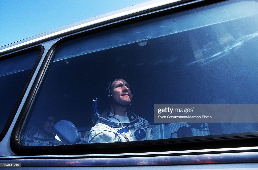 German astronaut Klaus Dietrich Flade looks out of the window of a bus that brings him and Russian cosmonauts to the spacecraft that will take them...