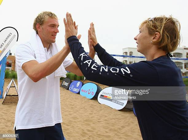 German athletes Martin Hollstein high five with Katrin WagnerAugustin during the Champion of the Year 2008 Award at Robinson Club Agadir on September...