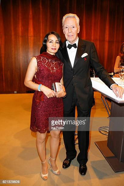 German autir Egon F Freiheit and his girlfriend Amira attend the 23rd Opera Gala at Deutsche Oper Berlin on November 5 2016 in Berlin Germany