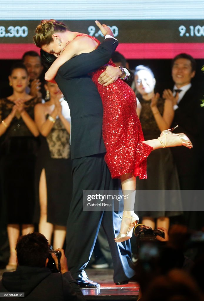 German Ballejo and Magdalena Gutierrez of Argentina celebrate after winning the final round of the Tango Salon competition as part of the Buenos Aires International Tango Festival and Championship 2017 at Luna Park on August 22, 2017 in Buenos Aires, Argentina.