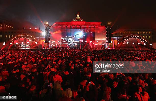 German band Clueso performs in front of the Brandenburg Gate during celebrations on the 25th anniversary of the fall of the Berlin Wall on November 9...