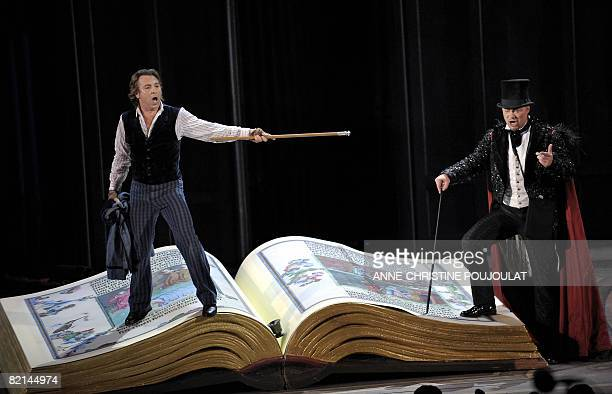 German basse Rene Pape as Mephistopheles and French tenor Roberto Alagna as Faust perform on July 31 in Gounod's Opera 'Faust' directed by Nicolas...