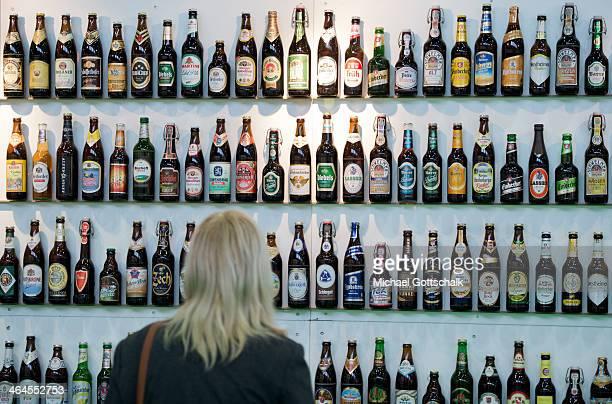 German beers in bottles on a shelf on the stand of the German Getraenkewirtschaft on Gruene Woche fair on January 17 2014 in Berlin Germany