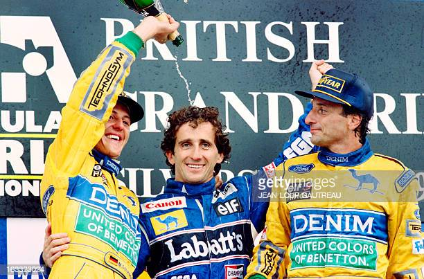 German BenettonFord driver Michael Schumacher sprays champagne over French WilliamsRenault driver Alain Prost as Italian driver Riccardo Patrese...