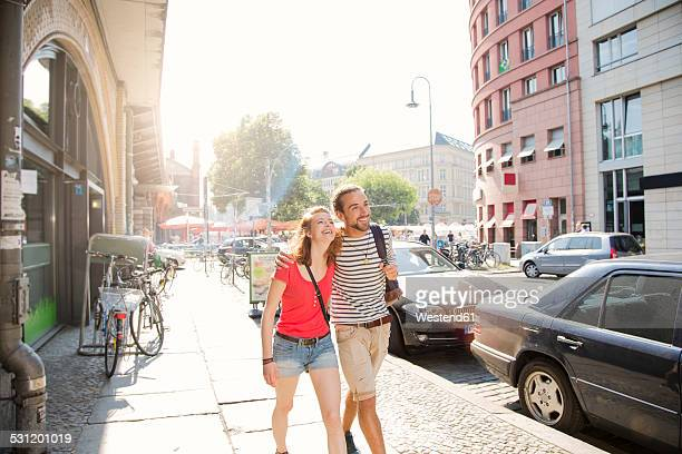 German, Berlin, Young couple walking in street