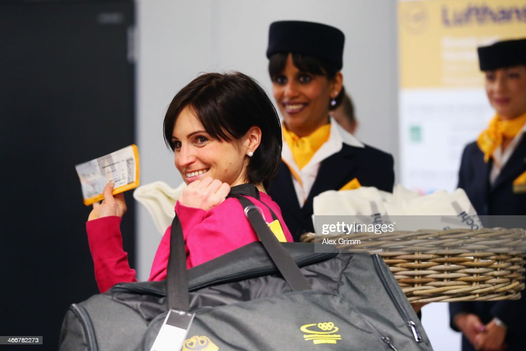 German biathlete <a gi-track='captionPersonalityLinkClicked' href=/galleries/search?phrase=Andrea+Henkel&family=editorial&specificpeople=233764 ng-click='$event.stopPropagation()'>Andrea Henkel</a> waves as Team Germany departs to the Sochi 2014 Winter Olympics from Frankfurt international airport on February 4, 2014 in Frankfurt am Main, Germany.