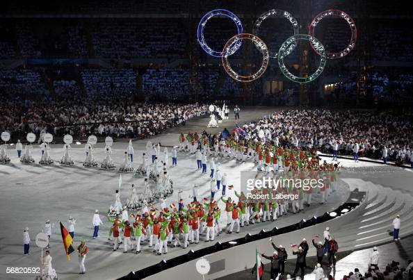 German biathlete athlete Kati Wilhelm carries the German flag as she attends the Olympic Stadium during the Opening Ceremony of the Turin 2006 Winter...