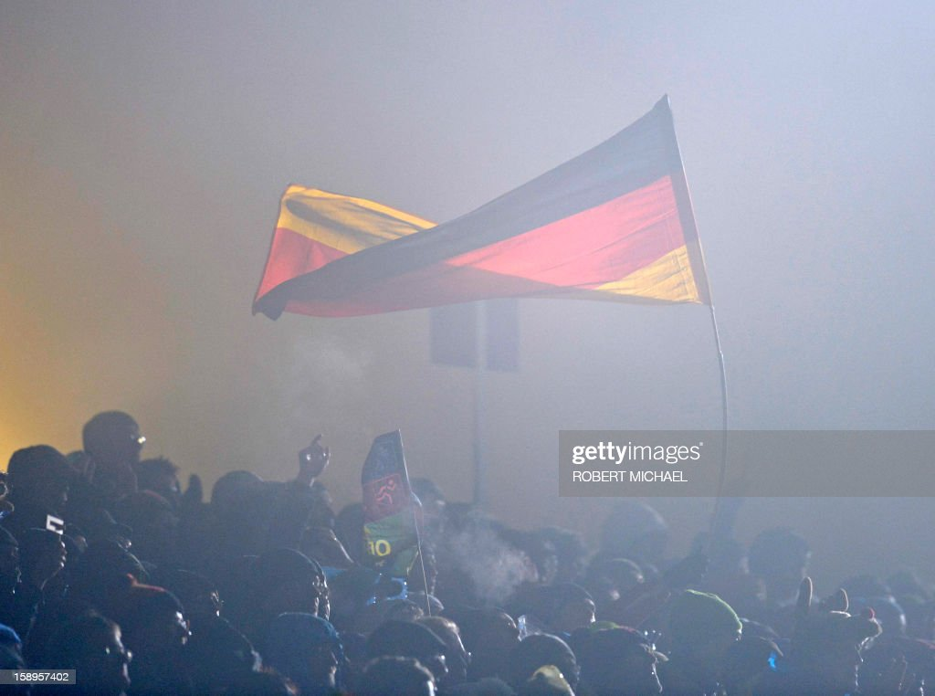 German biathlon fans wave a german flag during the Men's IBU Biathlon World Cup 4 x 7,5 km relay event in Oberhof, eastern Germany, on January 4, 2013. AFP PHOTO / ROBERT MICHAEL