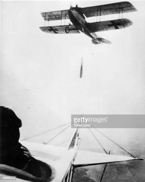 A German biplane drops a bomb