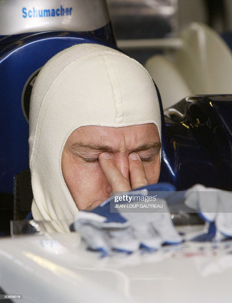 German BMW-Williams driver Ralf Schumacher sits in his car in the pits of the Monte-Carlo racetrack during the first free practice session three days before the Monaco Grand Prix, 20 May 2004 in Monaco.