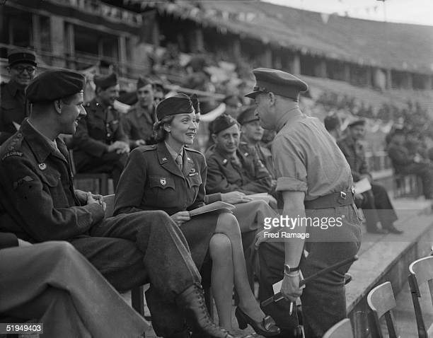 German born American actress Marlene Dietrich among the spectators at the Olympic Stadium in Berlin to watch the first interallied athletic meeting...