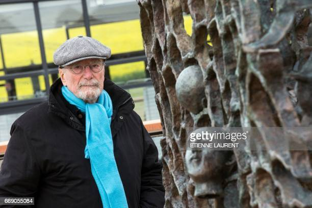 German born and French artist Haim Kern stands next to his sculpture entitled 'They didn't choose their tomb' during the commemorations of the 100th...