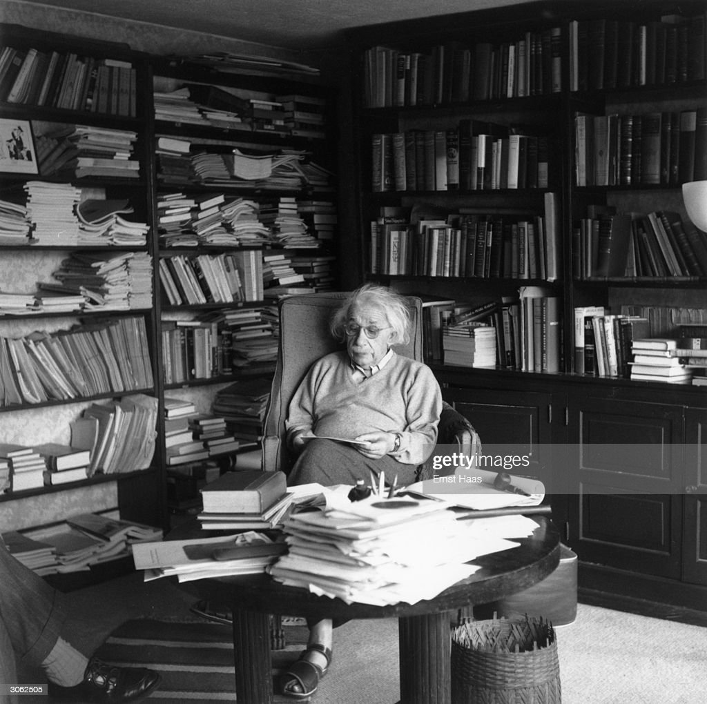 German born physicist who formulated the theories of relativity, Albert Einstein (1879 - 1955) ponders a problem in his paper-filled study in Princeton, New Jersey. A Nobel prize-winner for Physics in 1921.