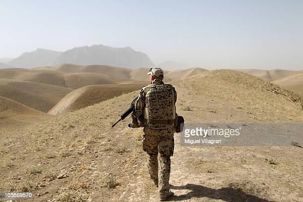 A German Bundeswehr patrols high ground during a regular patrol on October 17 2010 near MazareSharif Afghanistan Germany has more than 4500 military...