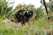 August 23, 2010 - A German Bundeswehr soldier demonstrates how to camouflage himself to blend into his surroundings during a German-led platoon attack mission with a U.S. Sapper squad in support, at G
