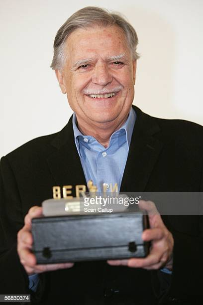 German cameraman Michael Ballhaus holds his Berlinale Camera Award at the Berlinale Berlin's international film festival February 12 2006 in Berlin...