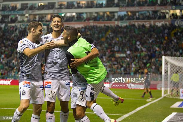 German Cano of Leon celebrates after scoring his team's third goal with with Mauro Boselli Guillermo Burdisso and Maximiliano Moralez during the...