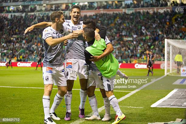 German Cano of Leon celebrates with teammates Mauro Boselli Guillermo Burdisso and Maximiliano Moralez after scoring during the quarter finals first...