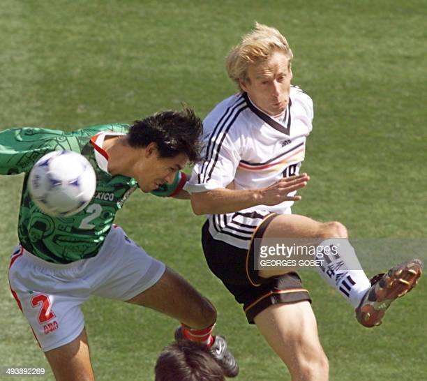 German captain Jurgen Klinsmann duels with Mexican defender Claudio Suarez 29 June at the Stade de la Mosson in Montpellier south of France during...