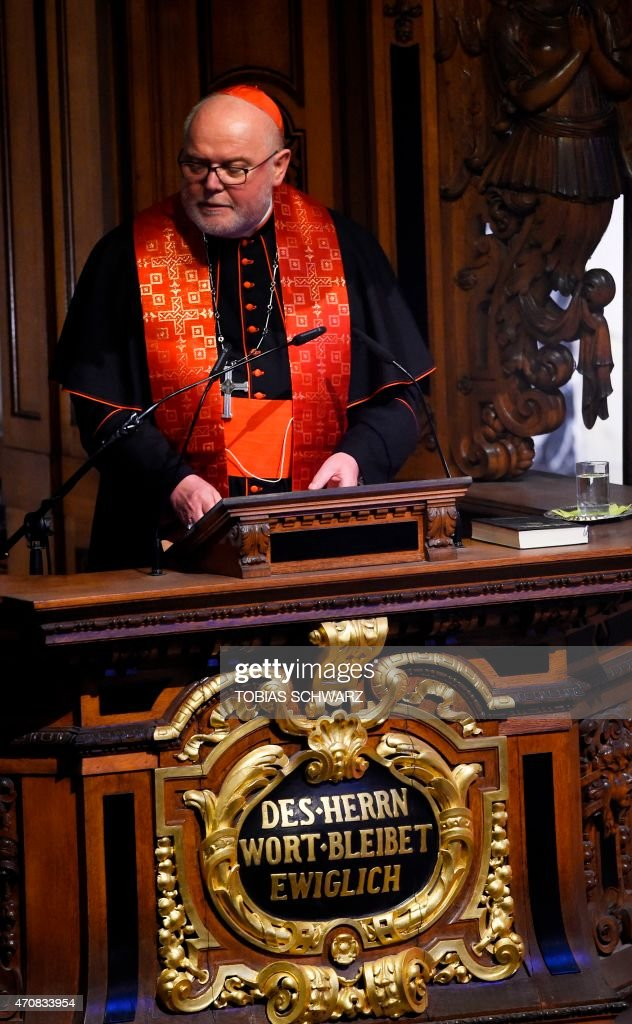 German Cardinal <a gi-track='captionPersonalityLinkClicked' href=/galleries/search?phrase=Reinhard+Marx&family=editorial&specificpeople=4687697 ng-click='$event.stopPropagation()'>Reinhard Marx</a> addresses a church service commemorating the centenary of the massacre of 1,5 million Armenians by Ottoman forces at the Cathedral in Berlin on April 23, 2015.