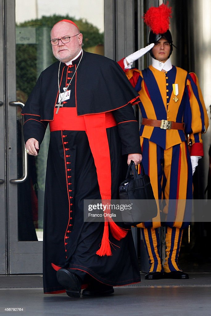 German Cardinal <a gi-track='captionPersonalityLinkClicked' href=/galleries/search?phrase=Reinhard+Marx&family=editorial&specificpeople=4687697 ng-click='$event.stopPropagation()'>Reinhard Marx</a> (L) leaves the Synod Hall at the end of a session of the Synod on the themes of family on October 7, 2014 in Vatican City, Vatican. In his 'Report prior to discussion' presented Tuesday morning to Synod Fathers and Fraternal delegates, the relator general Cardinal Peter Erdo, pointed to the 'privatization of love' as the greatest challenge to the family.