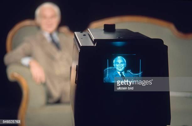 German cartoonist and actor Vicco von Bülow Loriot on his sofa in front of TV camera in the studio of Radio Bremen