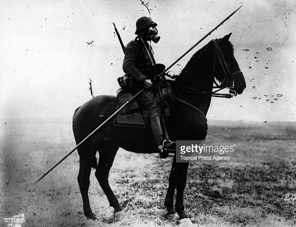 A German cavalryman wearing a gas mask and carrying a long spear or pole from two different ages of war
