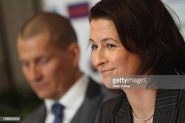German champion speedskater Claudia Pechstein flanked by her partner Matthias Grosse speaks at a press conference on the day of the lifting of her...
