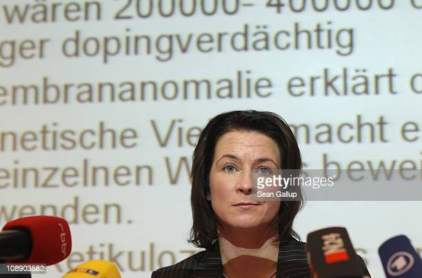 German champion speedskater Claudia Pechstein sitting under a projection of a description of red blood cell condition speaks at a press conference on...