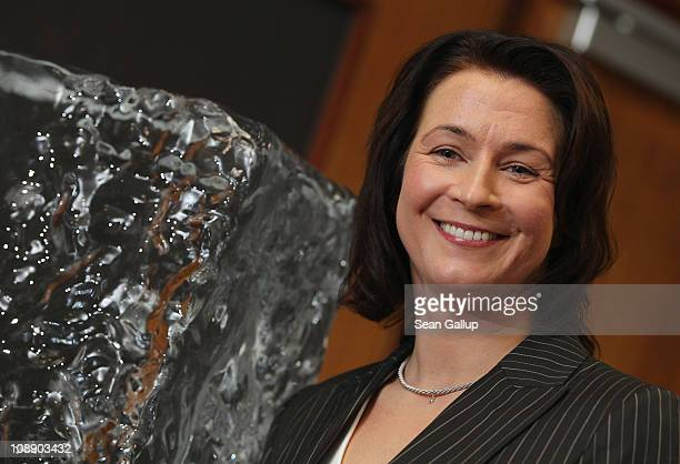 German champion speedskater Claudia Pechstein standing next to a block of ice speaks at a press conference on the day of the lifting of her twoyear...