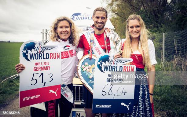 German Champions of Wings for Life World Run Bianca Meyer and Sebastian Hallmann pose after the Wings for Life World Run on May 7 2017 in Munich...