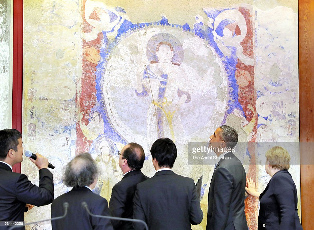German Chanceller Angela Merkel (1st R), U.S. President Barack Obama (2nd R) and French President Francois Hollande (4th R) watch the reproduced mural of the Bamiyan, which was restored after destruction by the Taliban, at the Exhibitions about anti-terrorism and the conservation of cultural properties prior to the working dinner during the Group of Seven summit on May 26, 2016 in Shima, Mie, Japan. The 2-day Group of Seven summit takes place to discuss key global issues such as global economy and counter terrorism measures.