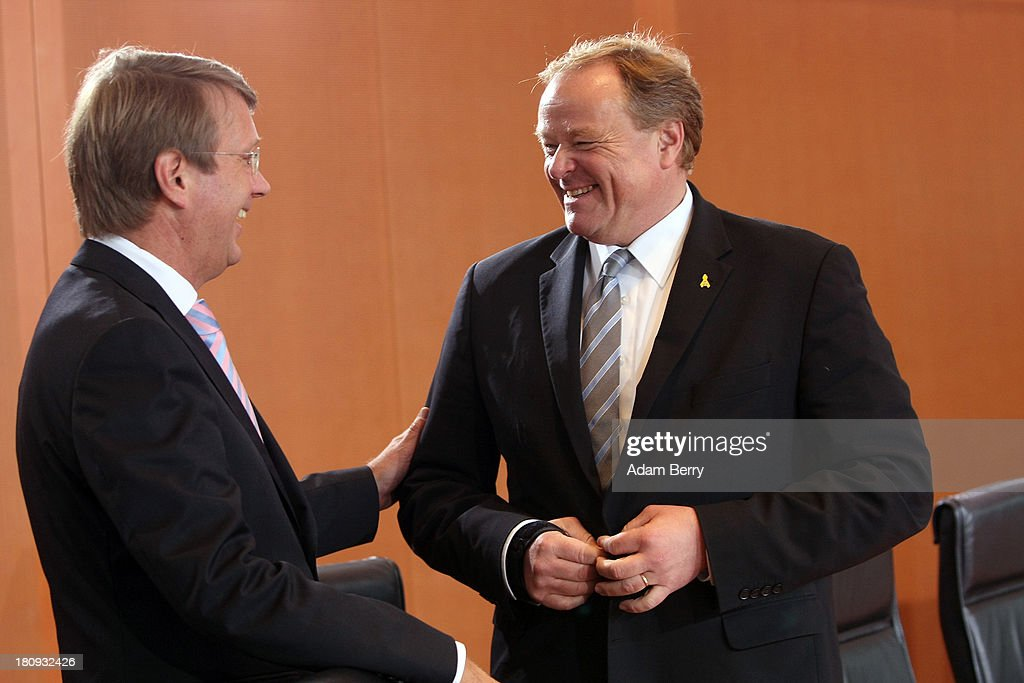 German Chancellery Chief of Staff <a gi-track='captionPersonalityLinkClicked' href=/galleries/search?phrase=Ronald+Pofalla&family=editorial&specificpeople=657117 ng-click='$event.stopPropagation()'>Ronald Pofalla</a> (L) and German Economic Cooperation and Development Minister Minister <a gi-track='captionPersonalityLinkClicked' href=/galleries/search?phrase=Dirk+Niebel&family=editorial&specificpeople=710721 ng-click='$event.stopPropagation()'>Dirk Niebel</a> arrive for the last weekly German federal Cabinet meeting of the current government on September 18, 2013 in Berlin, Germany. High on the morning's agenda was discussion of policies pertaining to a minimum wage.