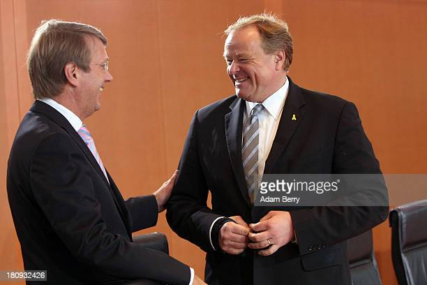 German Chancellery Chief of Staff Ronald Pofalla and German Economic Cooperation and Development Minister Minister Dirk Niebel arrive for the last...